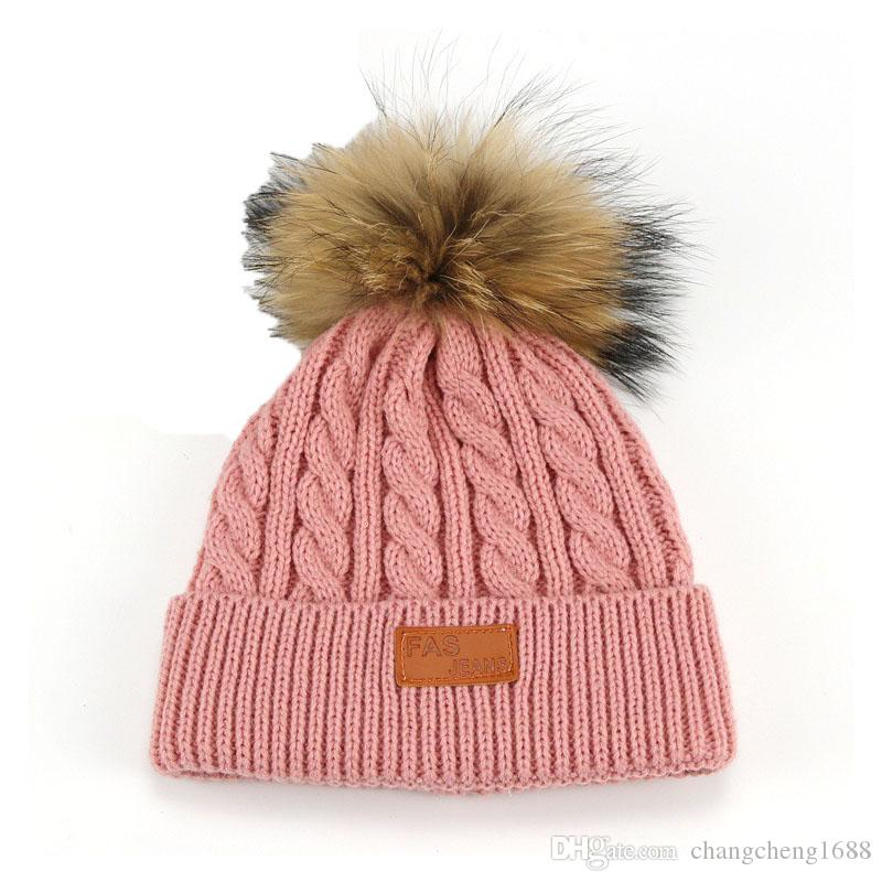 6c391a3b0b5 2017 Child Unisex Thick Cable Knit Beanies Faux Fur Pom Pom Hats Kids Solid  Color Winter Warm Cuffed Caps Skullcap MZ5052 Canada 2019 From  Changcheng1688