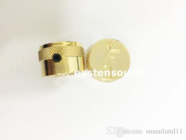 A Set of golden metal Control Knobs for Electric Guitar