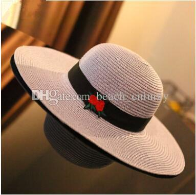 6c27e4553 Fashion wide Brim summer beach sun hats for women roses flower Embroidery  big straw Hats caps lady holiday sunscreen foldable hats 2017 new