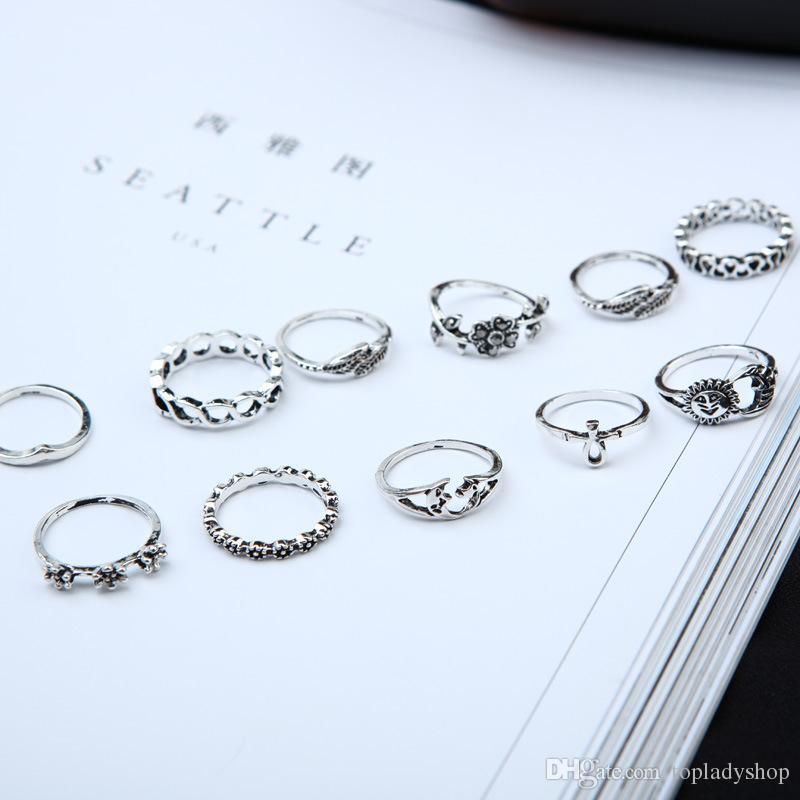 = flores aleación de diamantes hojas 11 juegos de anillos conjuntos de luna hueca cola whoelsale envío gratis