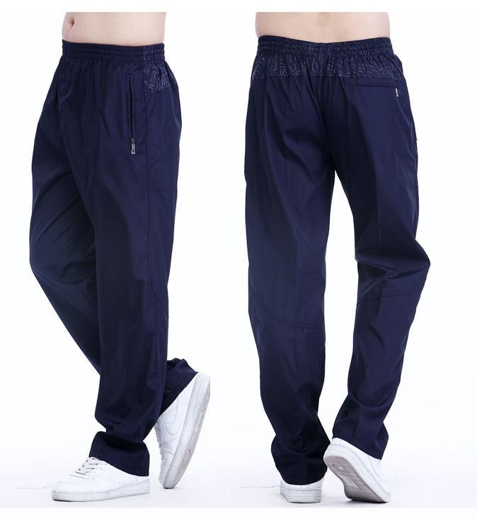Pantalons de sport en plein air hommes pantalons décontractés lâches pantalons décontractés avec poches mode pantalons longs en cours d'exécution hommes plus la taille