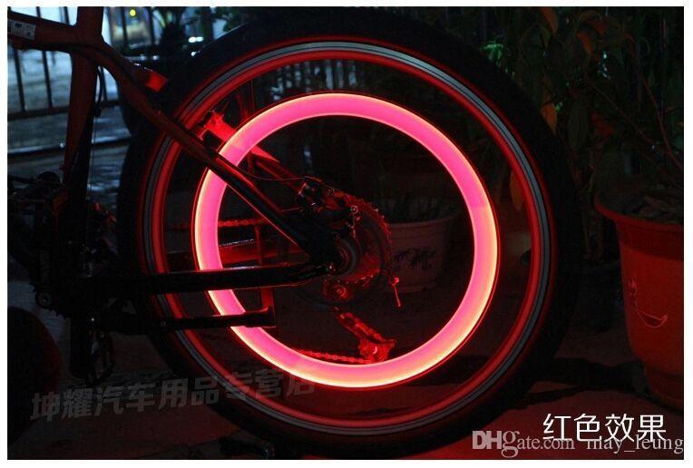 Envío libre al por mayor nuevo 4 unids / lote color de la mezcla de la bicicleta del coche rueda neumático tapa de la válvula habló neón Flash luces LED lámpara