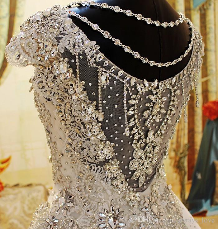 Vestidos de novia de lujo con cuentas de cristal Romántico Una línea Cap manga Tulle Encaje Apliques Mujeres largas Vestidos de fiesta nupciales