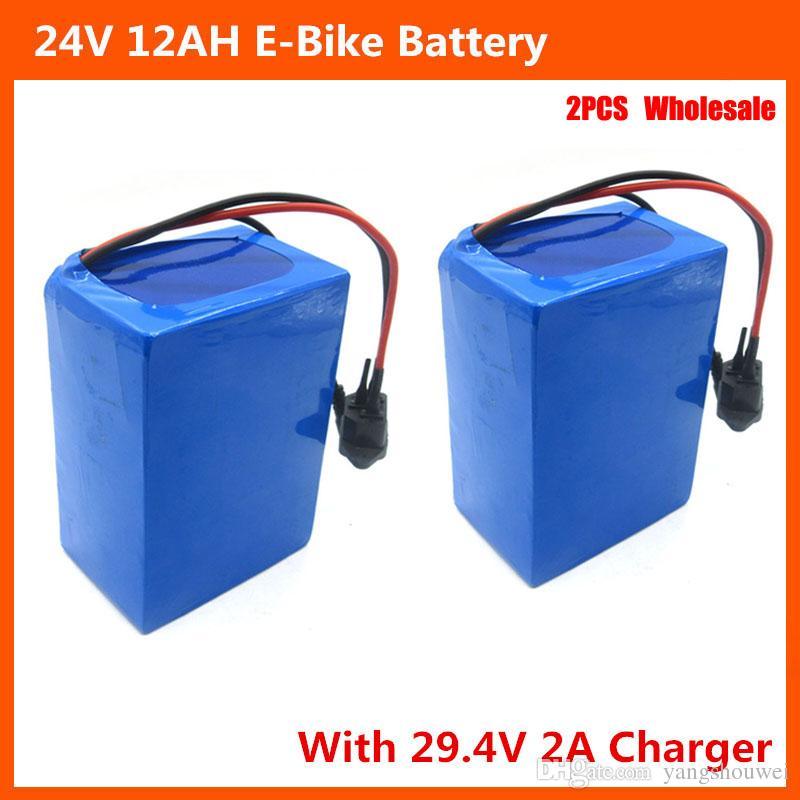 2 stücke großhandel Wiederaufladbare 24 V fahrradbatterie 24 V 12AH lithium-batterie mit PVC fall 15A BMS 29,4 V 2A ladegerät kostenloser versand