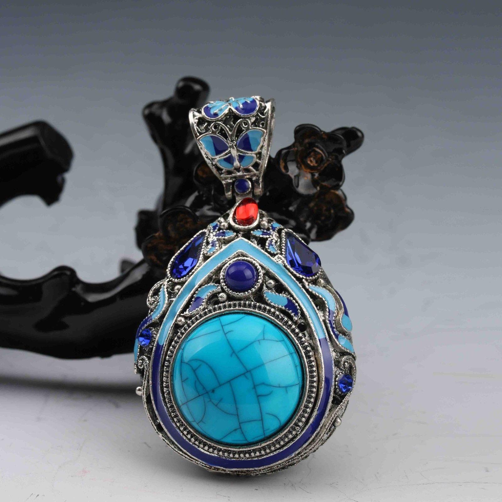 Exquisito colgante de forma de pera con forma de pera de plata turquesa con incrustaciones de plata tibetana con incrustaciones