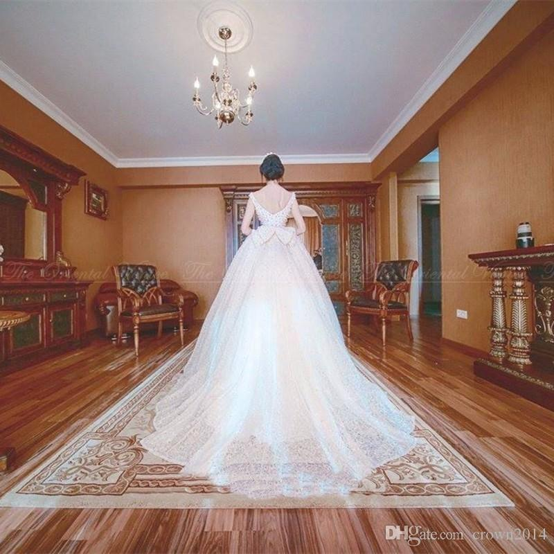 Luxury Lace Princess Ball Gown Wedding Dresses 2019 Scoop Neck Pearls Backless Lebanon Designer Bridal Dresses with Bow Court Train