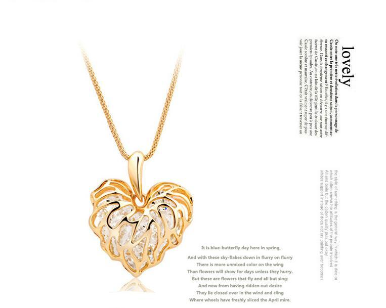 Hollow gold love leaf with shiny zircon necklace pendant Long necklace Alloy Gold Silver Sweater chain ornaments Clothing accessories