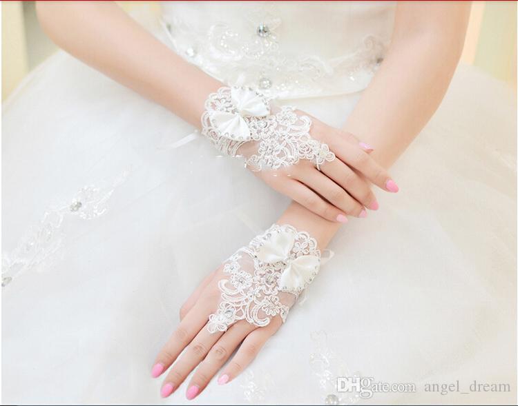 Marka Yeni Kısa Gelin Eldiven Moda Parmaksız Düğün Eldiven Düğün için Yay ile Zarif Prenses Beyaz / Fildişi Gelin Aksesuarları