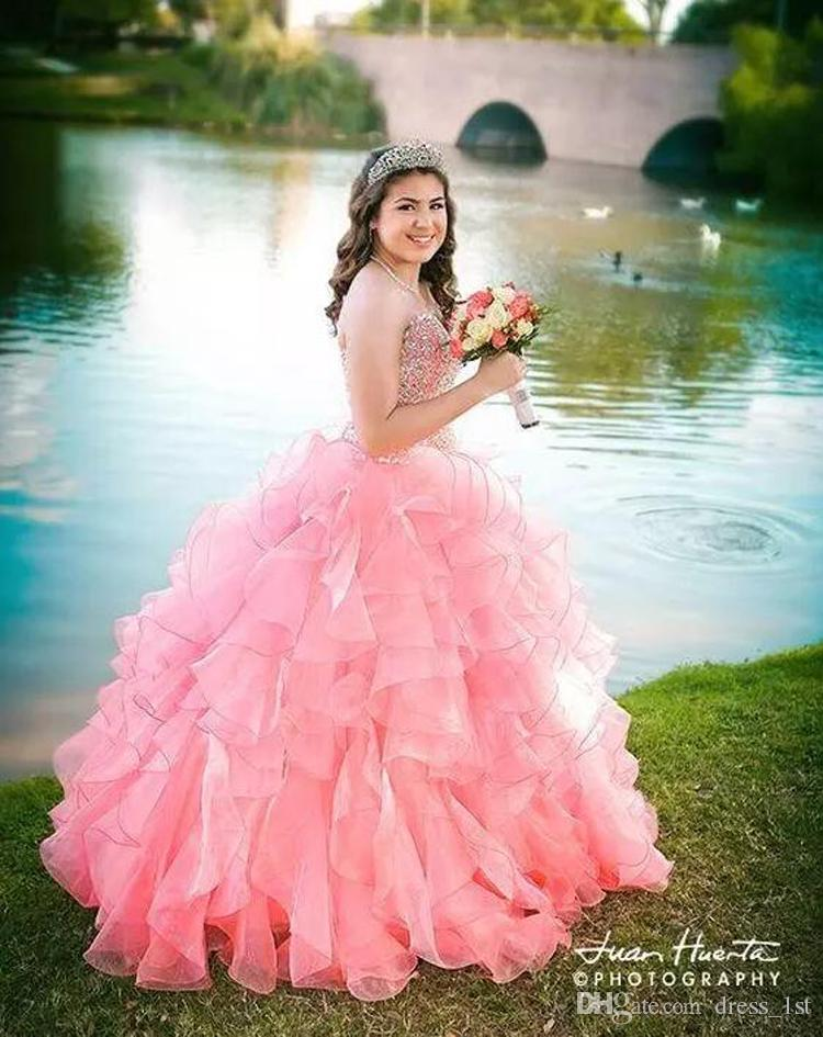 2017 Pink Organza Ruffles Ball Gown Quinceanera Dresses Exquisite Rhinestones Crystal Beaded Sweetheart Lace Up Back Sweet 15 Gowns EN9281