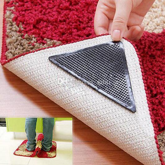 Nuevo 4 unids / set Reutilizable Lavable Alfombra Alfombra Esteras Pinzas antideslizantes Silicona Grip For Home Bath Salón