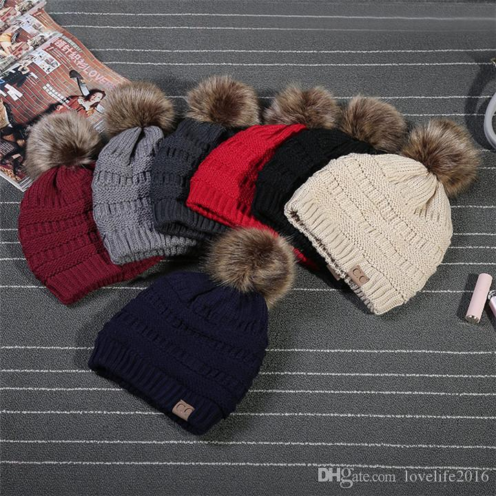 4789f11b472 Unisex Cc Trendy Hat Winter Warm Knitted Beanie With Fur Poms Label Fedora  Elegant Cable Slouchy Skull Cap Fashion Leisure Outdoor Hats A114 Hats And  Caps ...