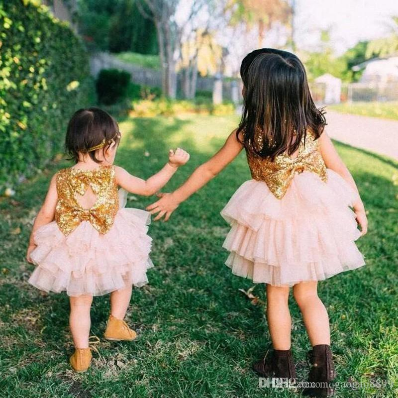 Blingbling Gold Sequined Blush Pink Baby Dresses With Bow 2019 Tiered Knee Length Flower Girl Dresses For Wedding cheap Princess Gowns