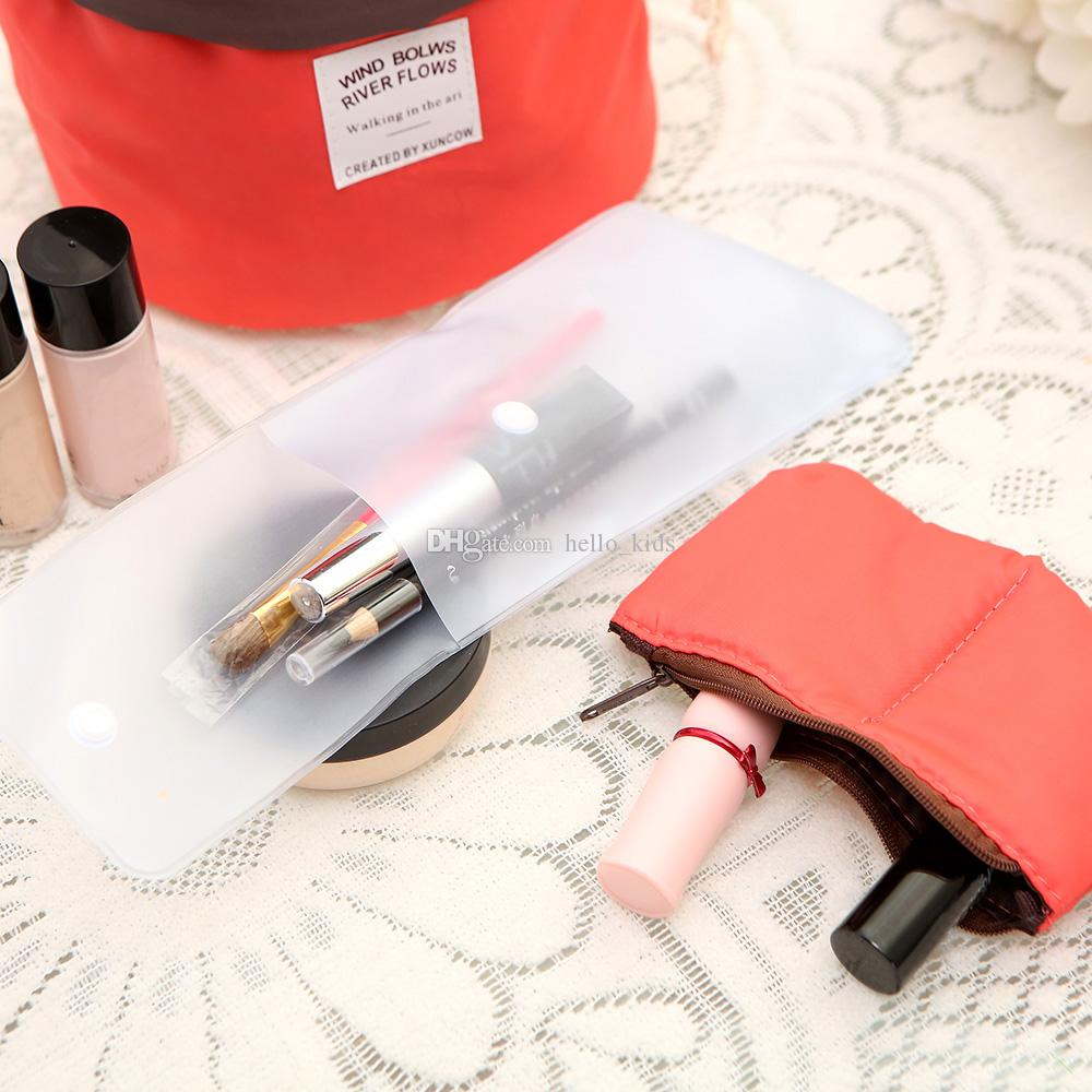2017 Mujeres de agua a prueba de bolsas de almacenamiento Mami Cilindro de pañales bolsas de maquillaje de nylon con asas de bolsa de viaje Pañaleras