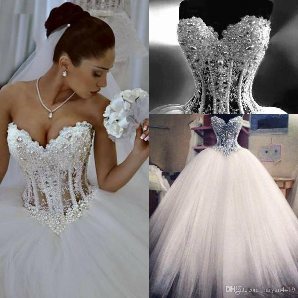 Discount 2018 Cheap Puffy Ball Gown A Line Wedding Dresses Sweetheart See  Through Floor Length Princess Tulle Crystal Bridal Gowns Lace Pearls Custom  ... e33e2d0da47b