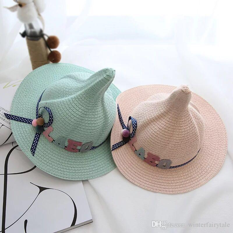 9d1d712f1f5 New Girls Spring And Summer Nipple Beach Straw Hat Children S Outdoor Sun  Hat Baby Hand Woven Fashion Pointed Witches Fisherman Hat Canada 2019 From  ...