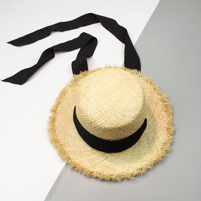 Causey Summer Women Beach Sun Uv Protection Hat Caps Raffia Black White  Ribbon Flat Straw Panama Hats With A Wide Brim 2018 New Hats And Caps  Fedora Hats ... e8462038f9ec