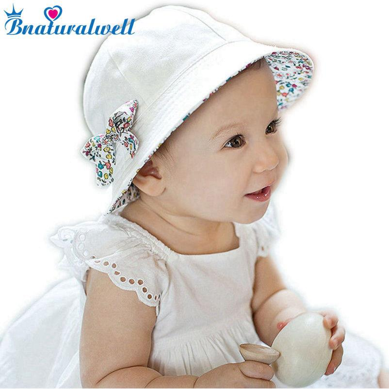 0fe453e7 2019 Toddler Hat Infant Baby Girls Floral Bowknot Bucket Hat Two Sided Coon Beach  Cap Summer Outdoor Sunshade Bucket Hats BS097 From Dejavui, ...