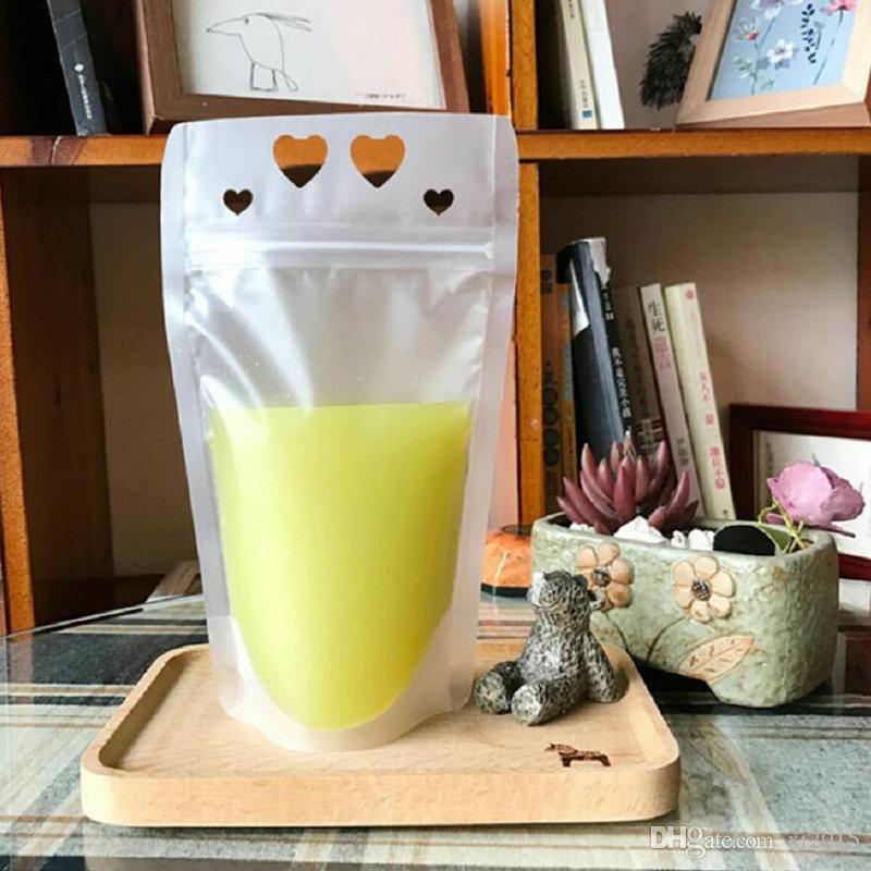 Bolsa de bebida sellada transparente helada 450ml con los agujeros en forma de corazón Bolsa de zumo de fruta independiente Envío libre wen6098