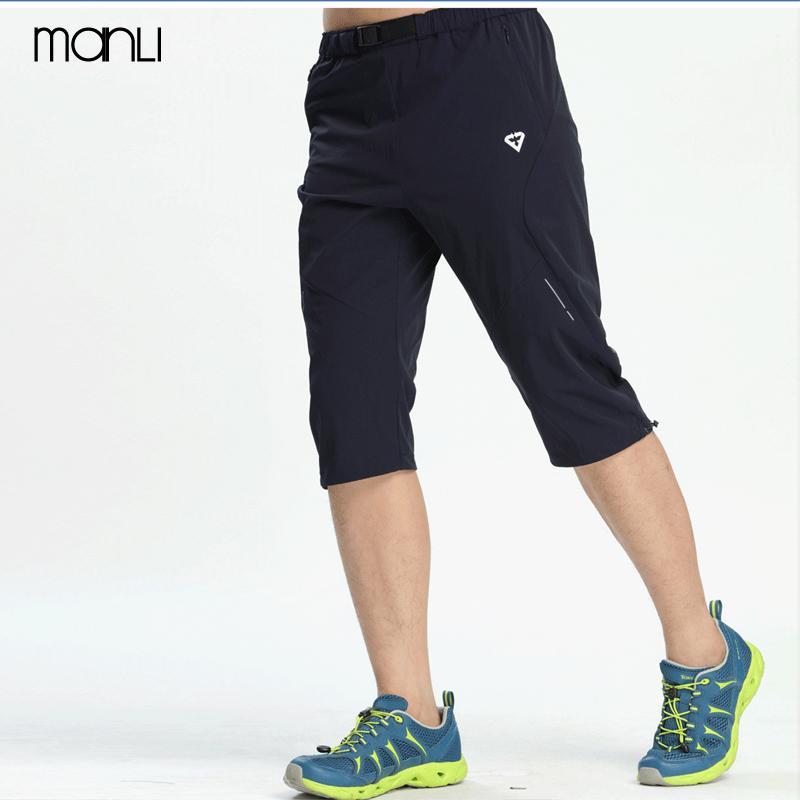 Compre MANLI Hombres Deportes Running Shorts Outdoor Masculino Fitness  Culturismo Entrenamiento Jogging Elástico Pantalones Cortos Más El Tamaño  5XL A ... d7cc8d6ac74