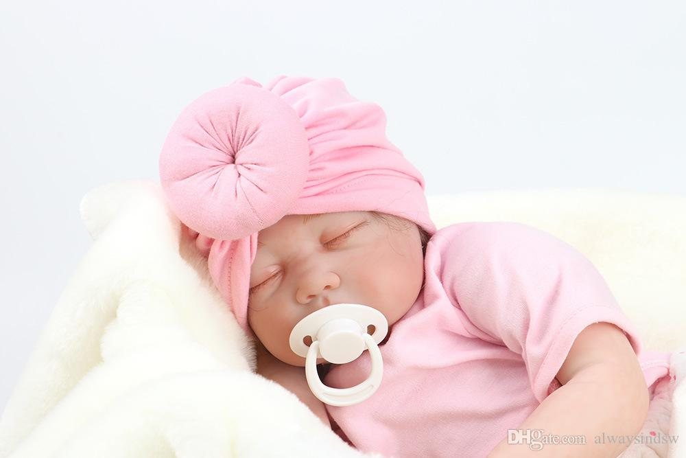 Fashion Cute Infant Baby Unisex Ball Knot Colorful Spring Cute Baby Donut  Elastic Hat Solid Color Cotton Hairband UK 2019 From Alwaysindsw c691aa69dd34