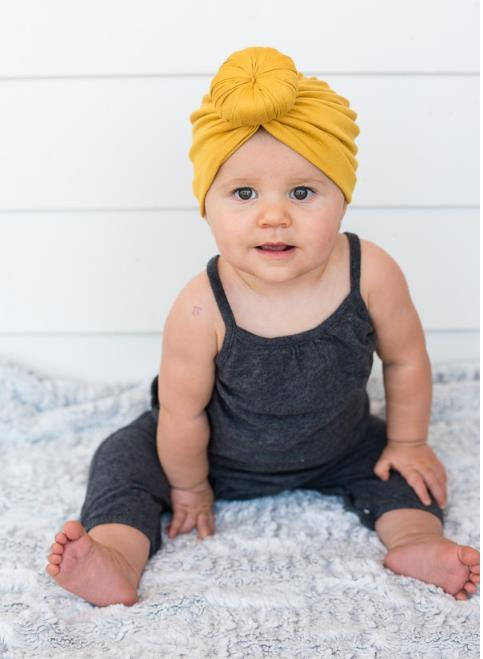 Moda Cute Infant Baby Kids Toddler Bambini Unisex Ball Knot Turbante indiano Colorful Spring Cute Baby Donut Hat in cotone tinta unita Hairban