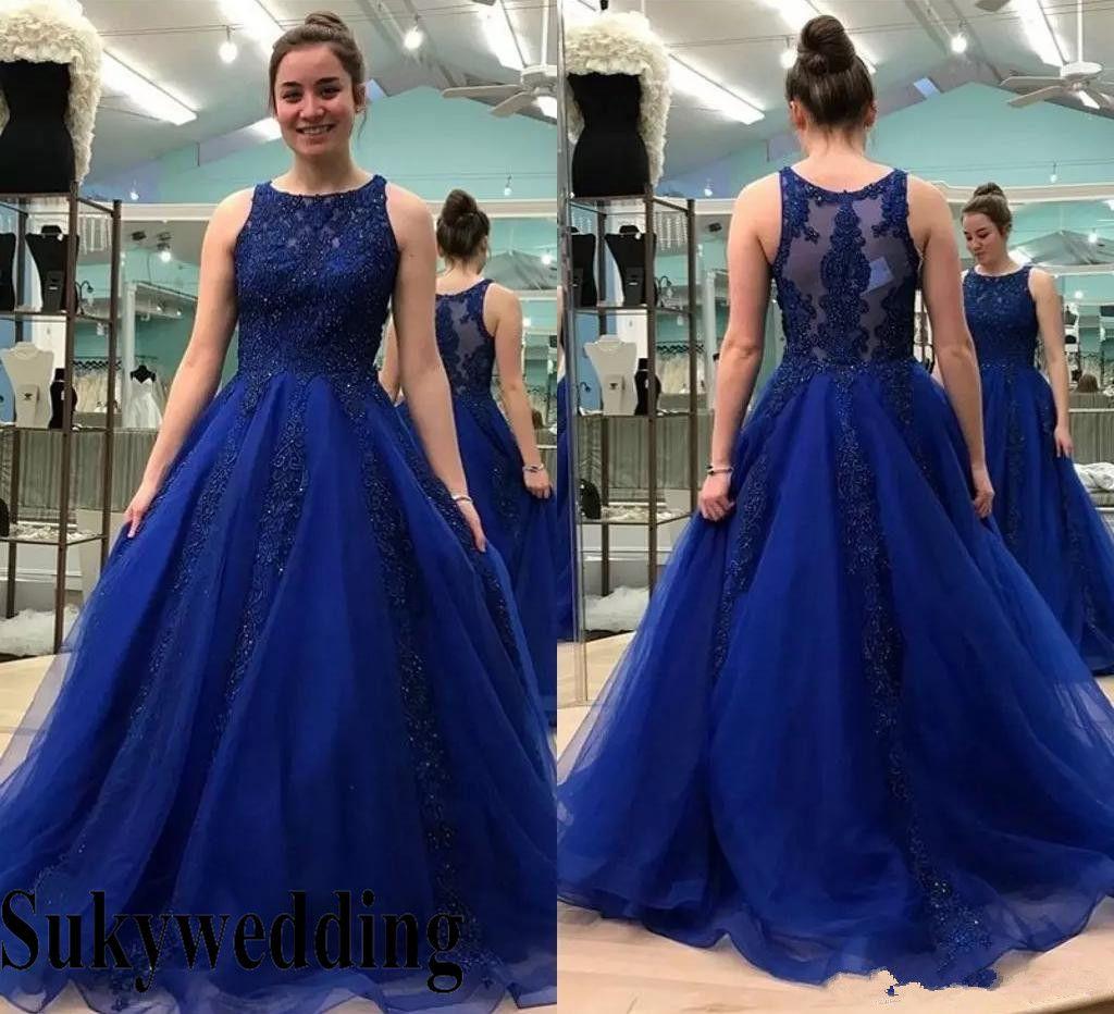 b6d4774fe5 Compre 2019 Royal Blue Quinceanera Vestidos Con Apliques Moldeados Escote  Redondo Tulle Sweet 16 Vestidos De Fiesta De Graduación 2019 Árabe Prom  Vestidos ...