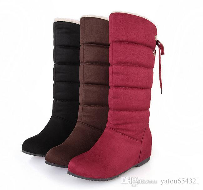 2019 winter snow boots lady flat and feather winter boots waterproof and velvet middle tube boots anti slip inside increased cotton boots.