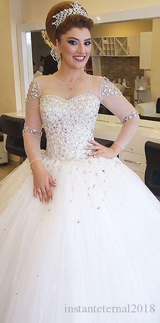 Cristalli di lusso in rilievo abito di sfera Abiti da sposa 2020 Modest Sheer collo Illusion lunghi Sleevd Paillettes vestiti nuziali Abiti da sposa di lusso