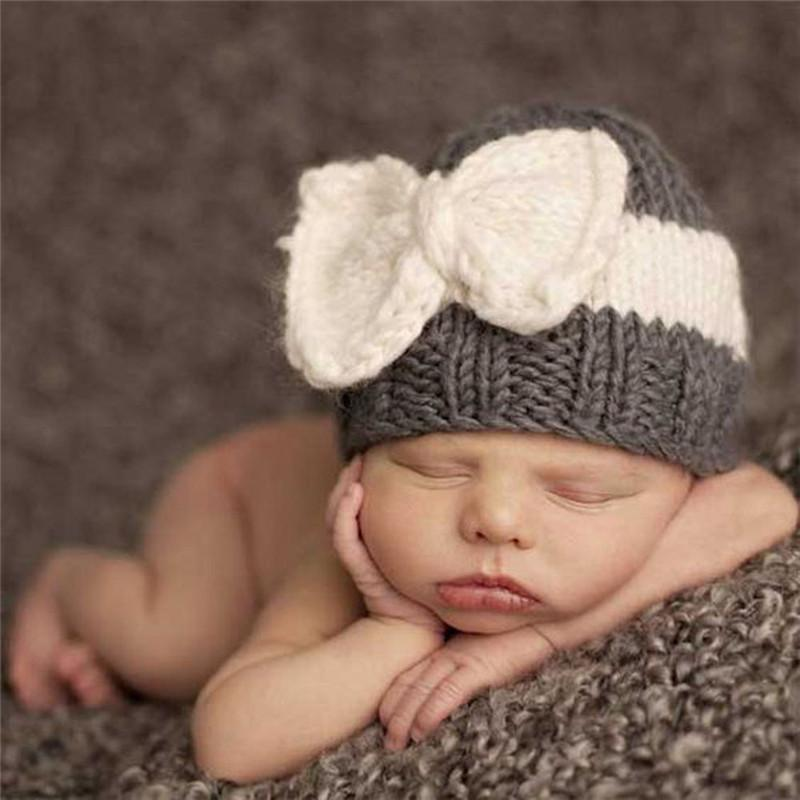 aae4a8cace809 2019 Knitted Kids Hats Warm Bow Knot Hat Fashion Girls   Boys Baby Infant  Toddler Winter Warm Crochet Knit Hat Newborn Beanie Caps From Fwuyun
