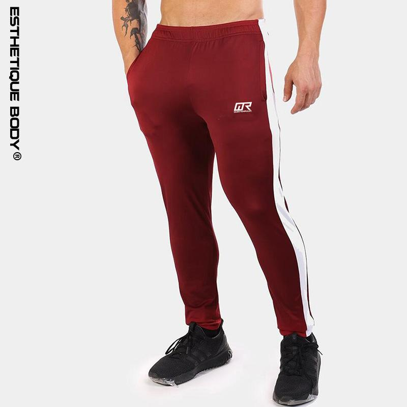c6a0be4103 2018 new brand sports pants men's gym running pants stitching hit color  jogging men men's running training trousers