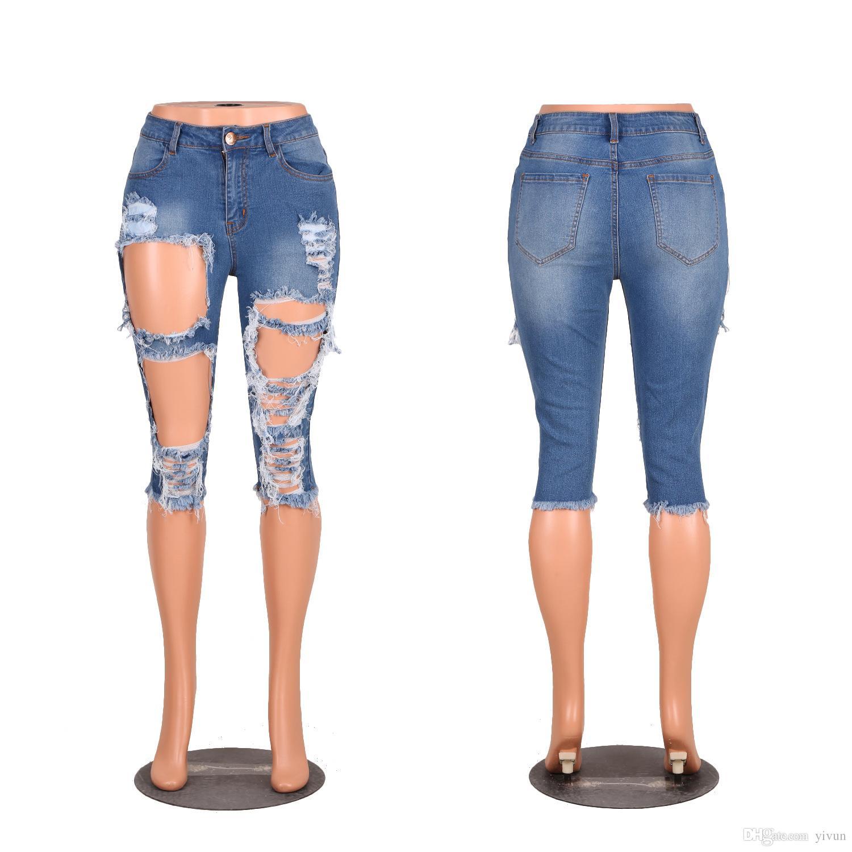 Ücretsiz kargo yivun Sıska Pantolon Diz Boyu Artı Boyutu Denim Sıska Pamuk Orta Bel Kot Yaz Tahrip Yırtık yarım 2018