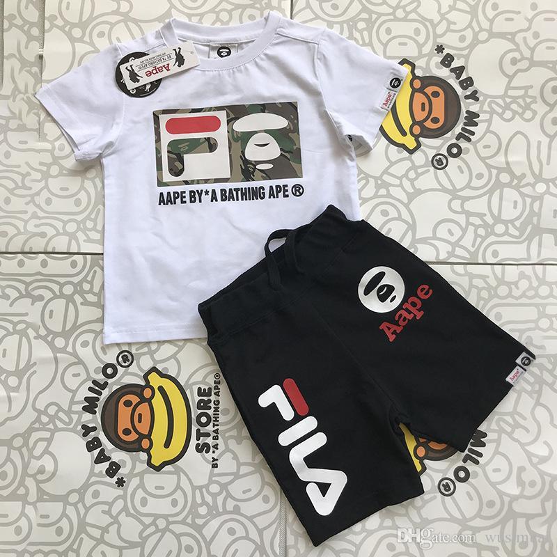 83c87e513f25 2019 Famous Logo Brand Luxury Kids Two Piece Suit Little Boy T Shirt Pants  Suit Summer Children S Clothing Sets From Wusimuai