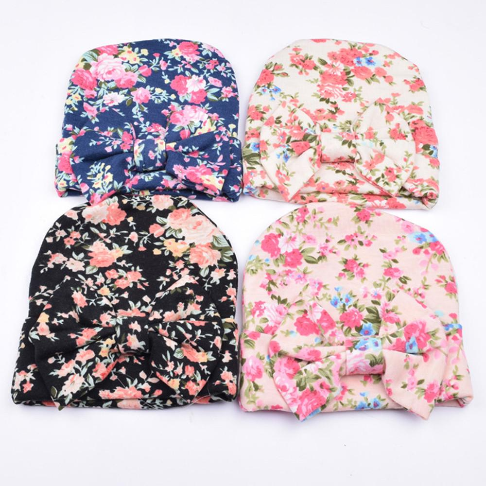 7a948f7dee8 2019 Newborn Hospital Hat Newborn Baby Hats With Flower Bowknot Flower Hat  2018 Pretty Style Attractive Cotton From Longanguo