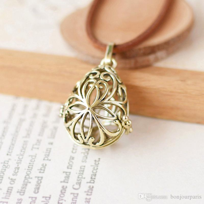 Hollowed Flower Drop Shaped Locket Bronze Aromatherapy Necklaces Pendants 70cm Long Sweater Rope Chain Locket Necklace for Girlfriend H01