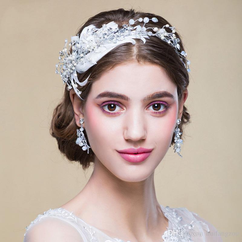 Fashion Feather Design Hairband 2018 Luxury White Rhinestone Faux Pearl  Wedding Headbands Unique Garden Bridal Accessories Headpieces For Bride  Jewellery ... ad9401bf1e2