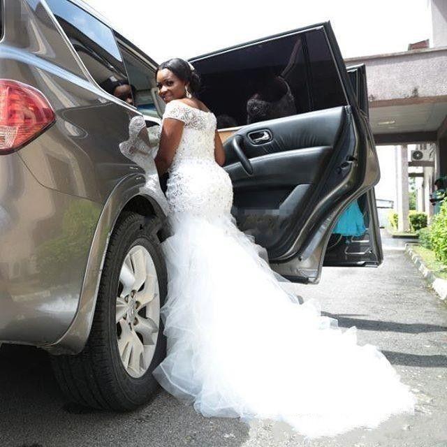 2020 Plus Size African Sirena Abiti da sposa Abiti perline perle perle Sheer Bateau Neck Roffled Maniche corte Abiti da sposa