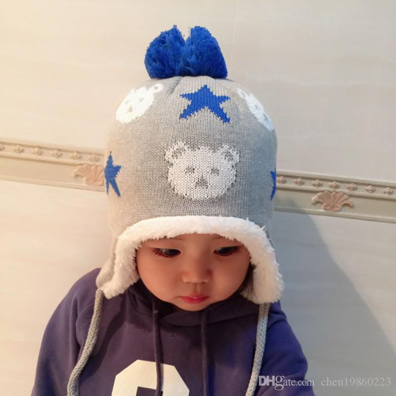afb2a429d2a Autumn And Winter Children S Hat Cotton Baby Earmuffs Plus Velvet Five  Pointed Star Hair Ball Knit Hat Ladies Hats Crazy Hats From Chen19860223