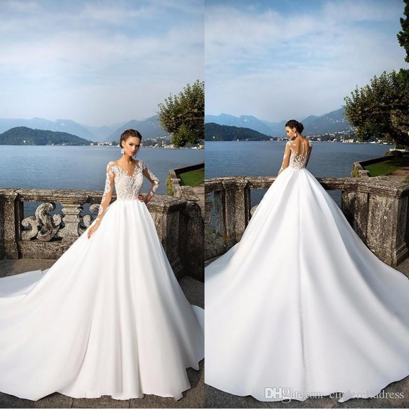 Milla Nova Sheer Long Sleeve Wedding Dresses 2018 Buttons Back Lace Appliques Satin Ball Gown Bridal Gowns Beach Wedding Gowns ba4502