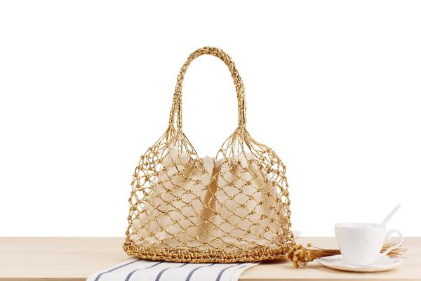 Wholesale and retail new solid color gold and silver line hand hook woven bag tide female Sen portable straw bag beach bag