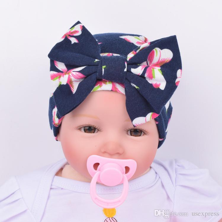fccb4155e61d6 2019 Newborn Baby Girl Floral Print Hat With Bow Cotton Bohemia Turban Toddler  Infant Beanie Baby Cap Hats Factory Wholesale From Usexpress