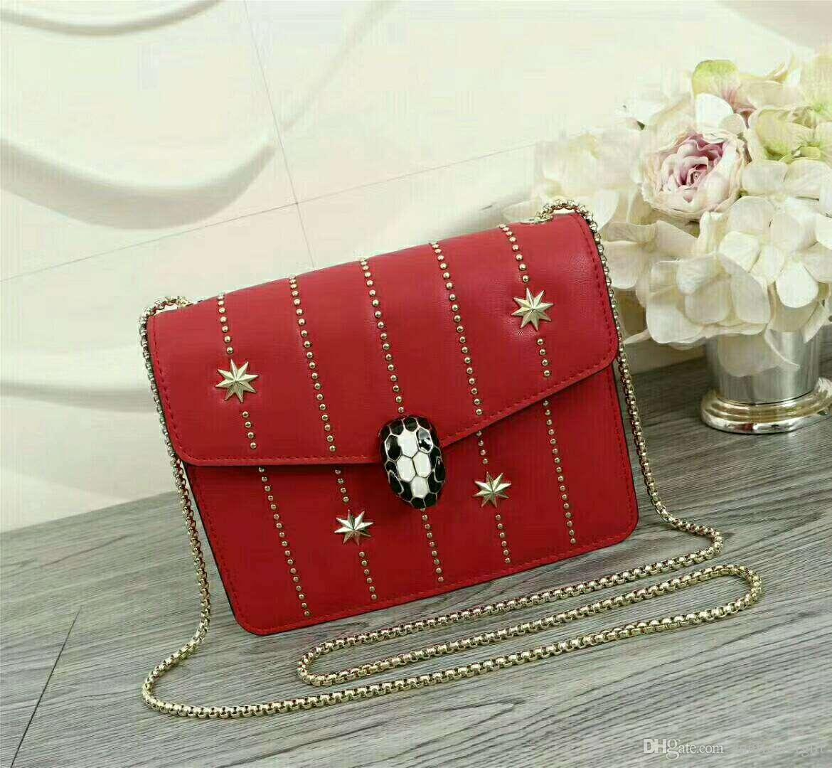 promote woman bag! High-grade classic quality genuine leather bag quality metal stars designed shoulder bags with snakeheads button