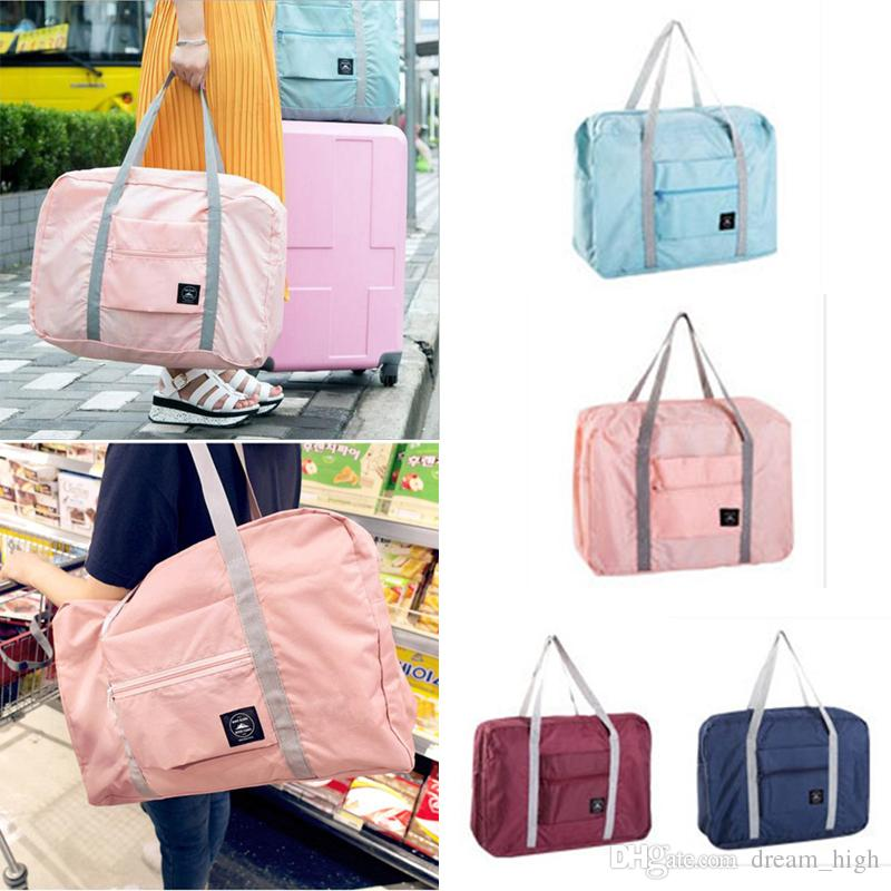 861c6718a14f 2019 25L Large Capacity Folding Carry Bag Waterproof Travel Luggage Packing  Bag Shopping Bag Clothes Storage Pouch Organizer Carry On Duffle From  Dream high ...