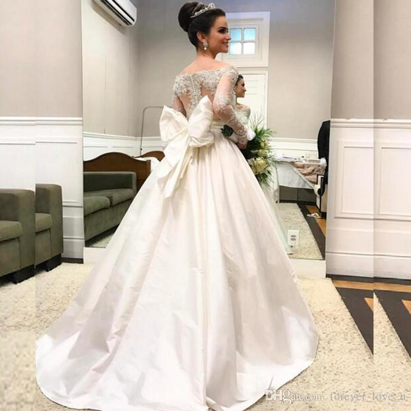 0e52a3a02067 Discount Arabic Long Sleeve Wedding Dresses Sheer Neck Off The Shoulder  Beaded Lace Appliques Illusion Back Taffeta Bridal Gowns With Oversize Bow  A Line ...