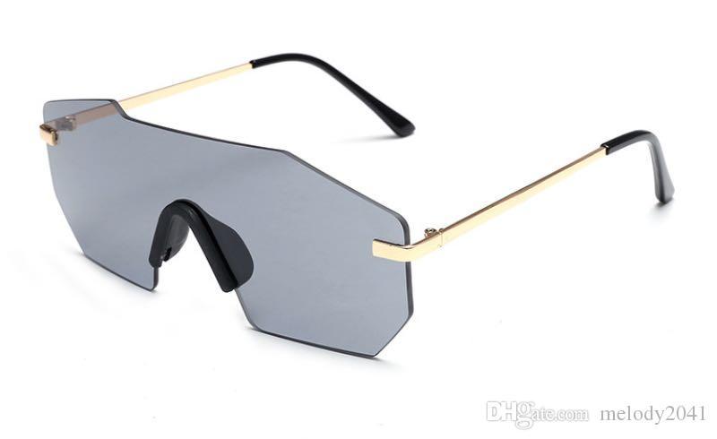 16bfd0abfd Compre Nueva Tendencia De Moda Irregular Gafas De Sol De Una Sola Pieza Con  Estilo Hombres Mujeres Gafas Sin Montura Personalidad Gafas Brillantes Al  Por ...
