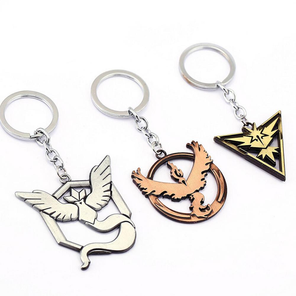 04c27eca4 Cartoon Figures Alloy Keychain Anime Articuno Zapdos Cute Pendants Keychain  Wholesale Pocket Monster Key Holder Remove Before Flight Keychain Self  Defense ...