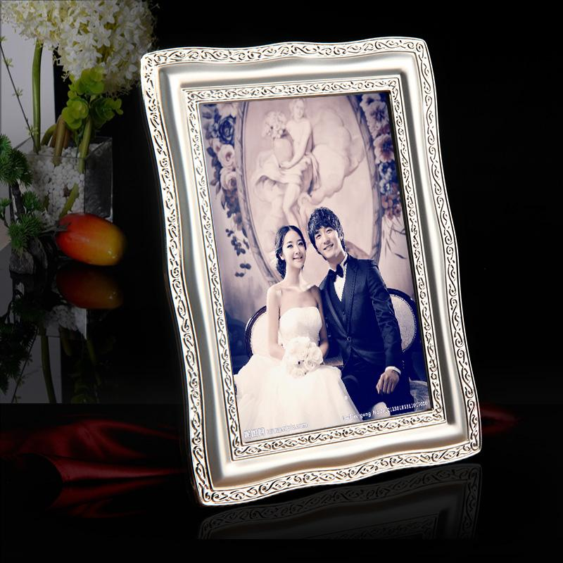 c2c8ceae3f77 2019 Creative Desktop And Wall Mounted Luxury Silver Plated Metal Photo  Frame Picture Frames MPF015 From Ilexer