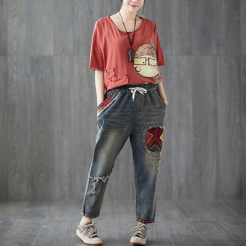 872db5cb63 Compre Más El Tamaño De Bordado Elástico De La Cintura Floja Pantalones  Vaqueros Del Harem Otoño Nuevo Vintage Parche Rasgado Mujeres Pantalones De  ...