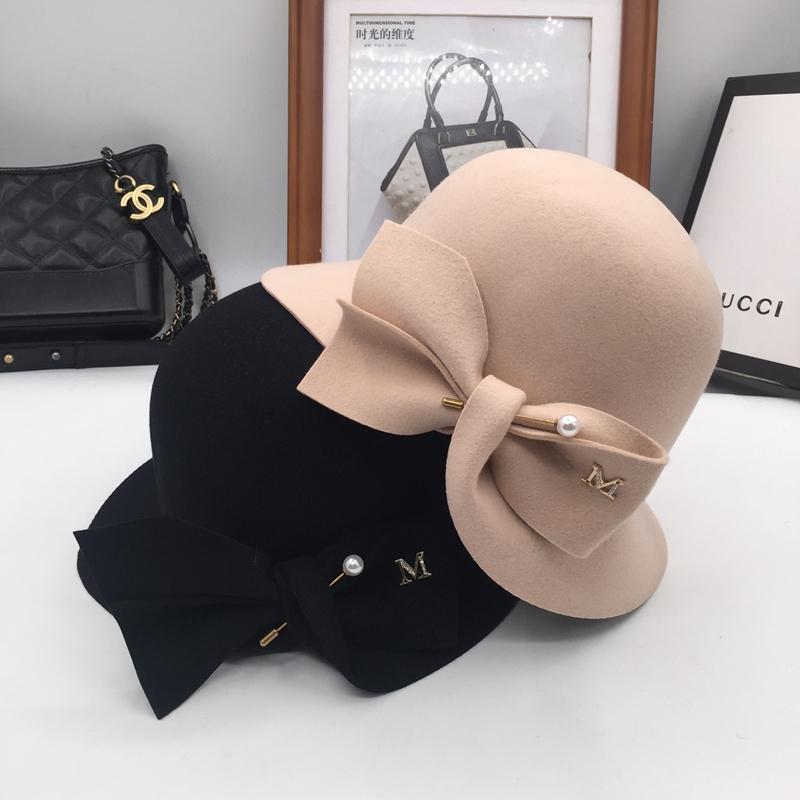 0b955a6b494 New Bucket Basin Of Bowknot Pearl Wool Hat Female Warm Fashion Fisherman Hat  Joker Eric Javits Flat Brim Hats From Playnice