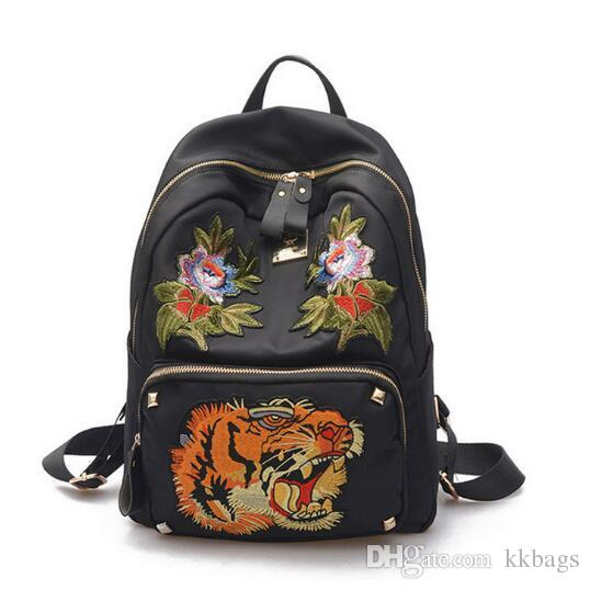 Rivet Embroidered With Tiger Head Backpack Students Oxford School Bags  Waterproof Travel Bag Cool Backpack Style Womens Backpacks Pink Backpacks  From Kkbags ... 5f6a49a682128