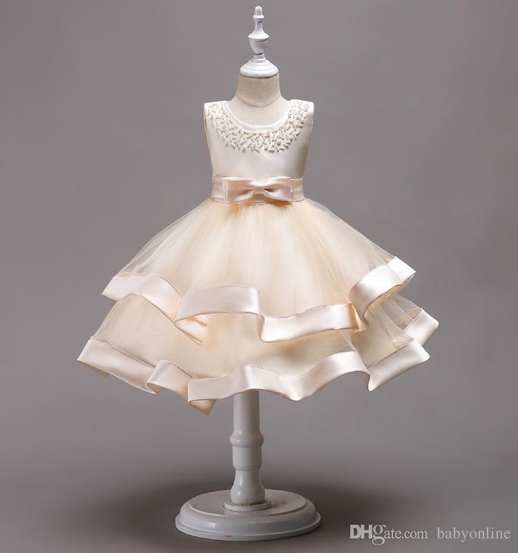 Encantadora longitud de la rodilla con cuentas con gradas vestidos de niña de flores Vestidos de desfile de niños de tul con nudo de arco Vestidos de primera comunión MC1490